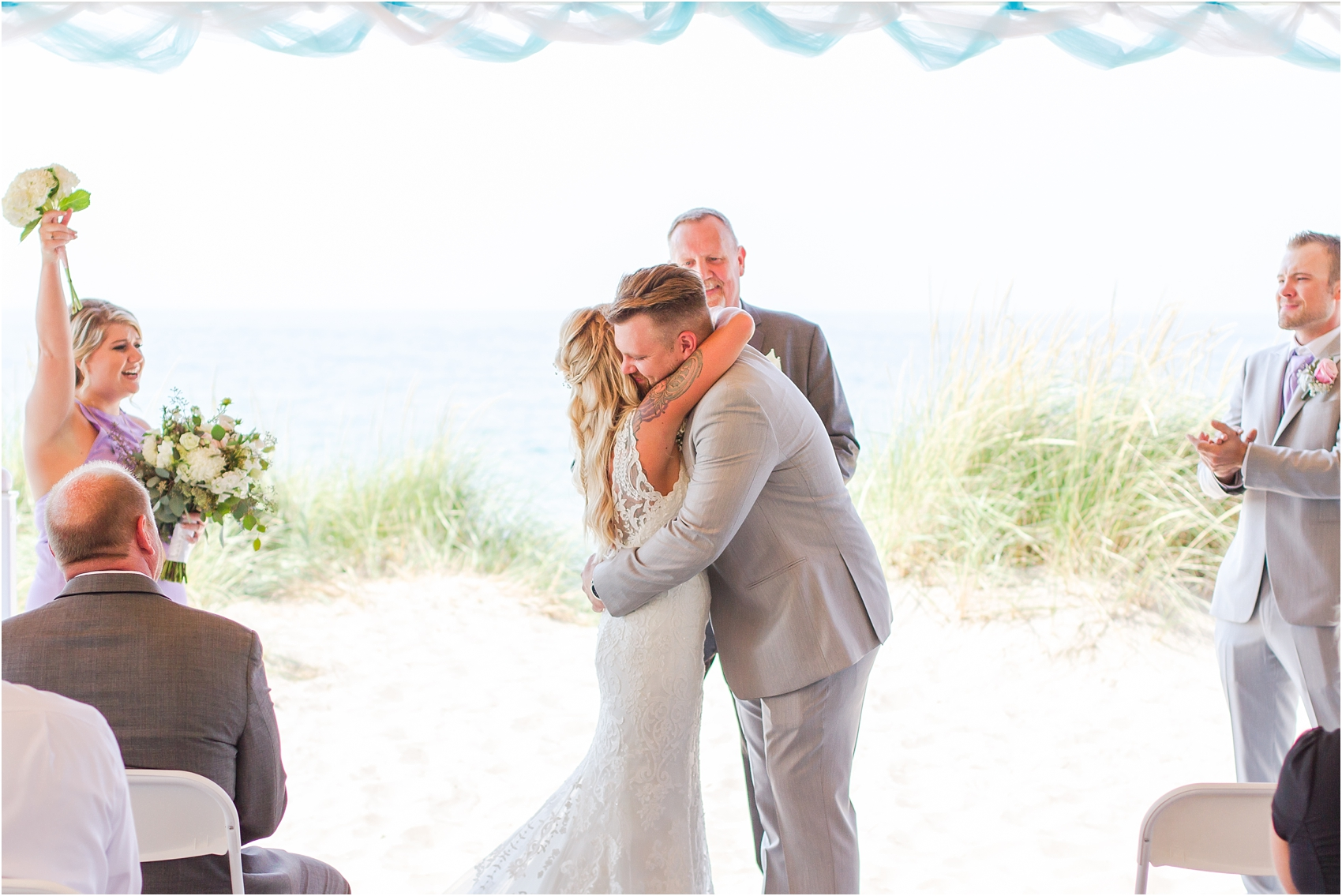 fun-whimsical-beach-wedding-photos-in-st-joseph-michigan-by-courtney-carolyn-photography_0071.jpg