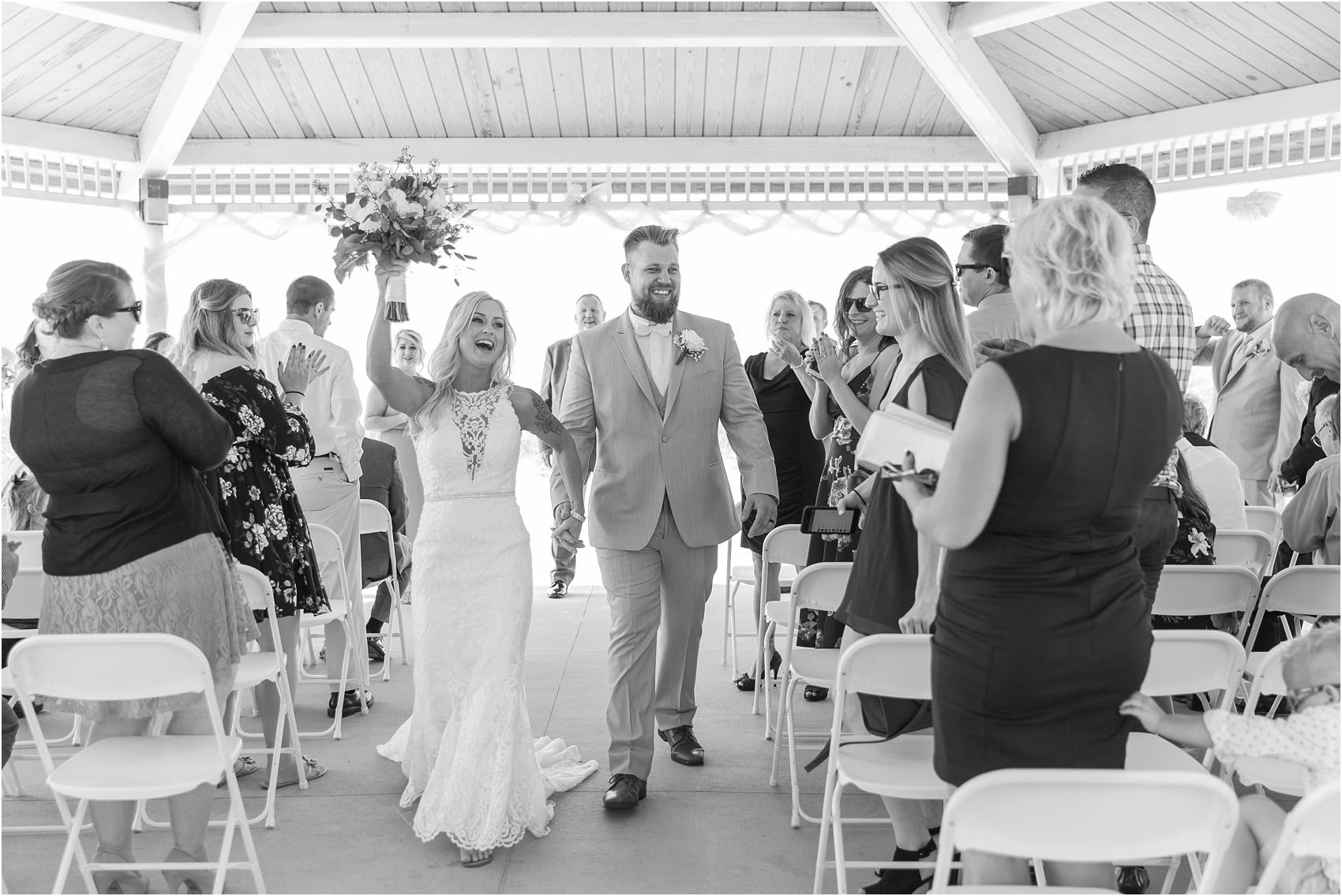 fun-whimsical-beach-wedding-photos-in-st-joseph-michigan-by-courtney-carolyn-photography_0073.jpg