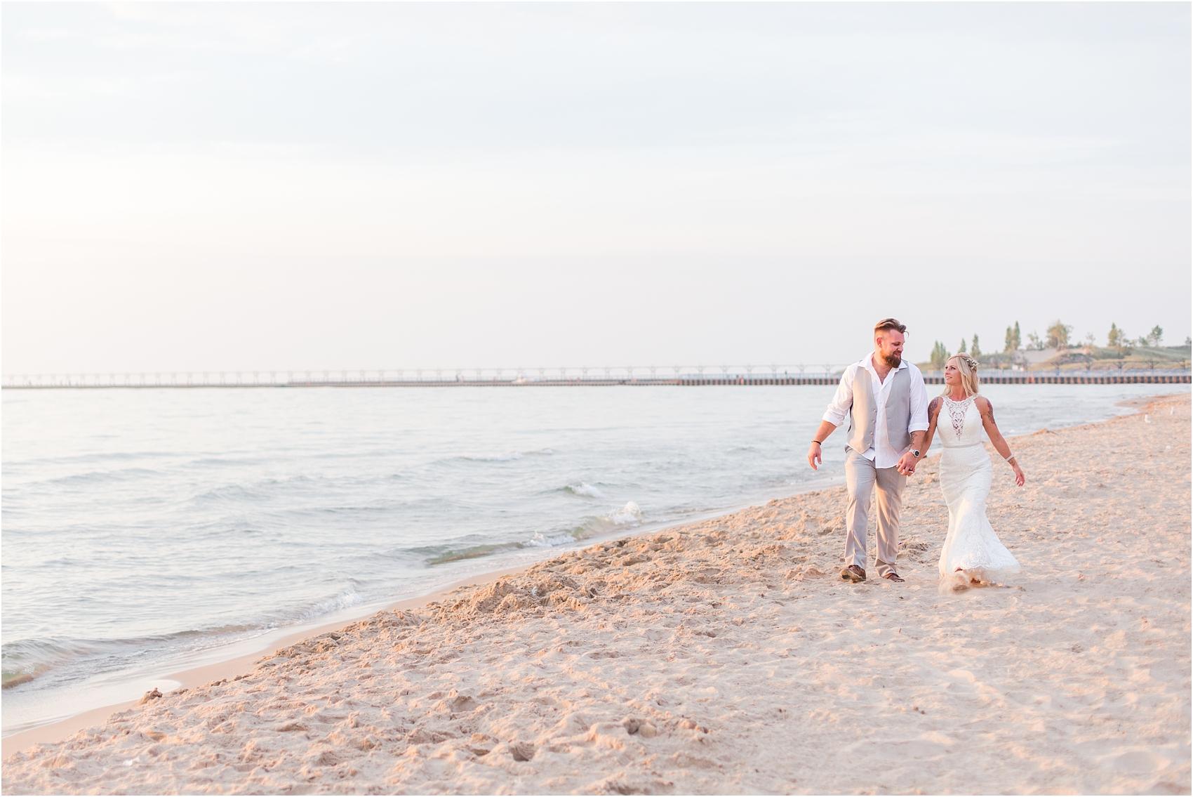 fun-whimsical-beach-wedding-photos-in-st-joseph-michigan-by-courtney-carolyn-photography_0098.jpg