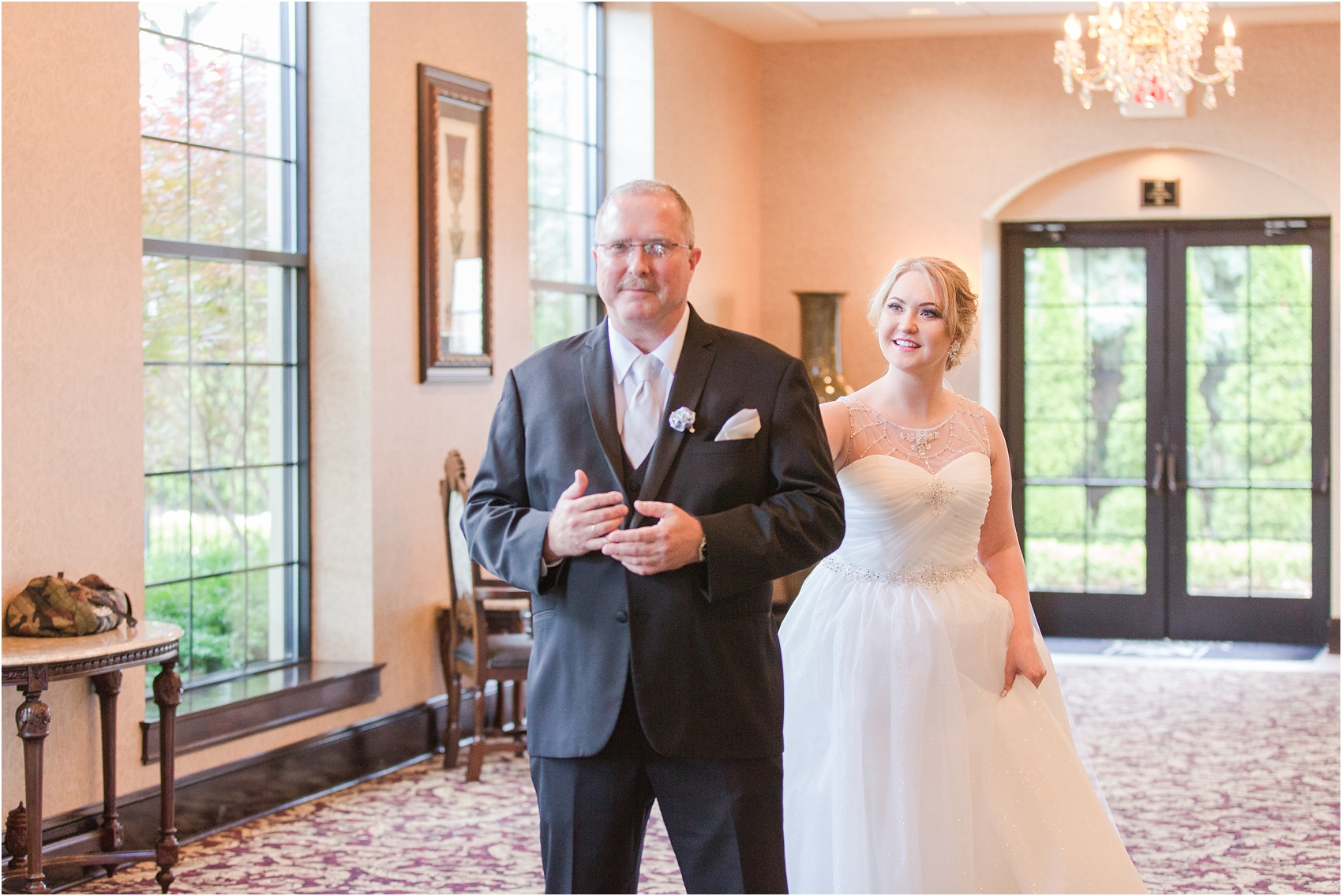 father-and-bride-share-emotional-first-look-on-wedding-day-photos-in-detroit-michigan-by-courtney-carolyn-photography_0002.jpg