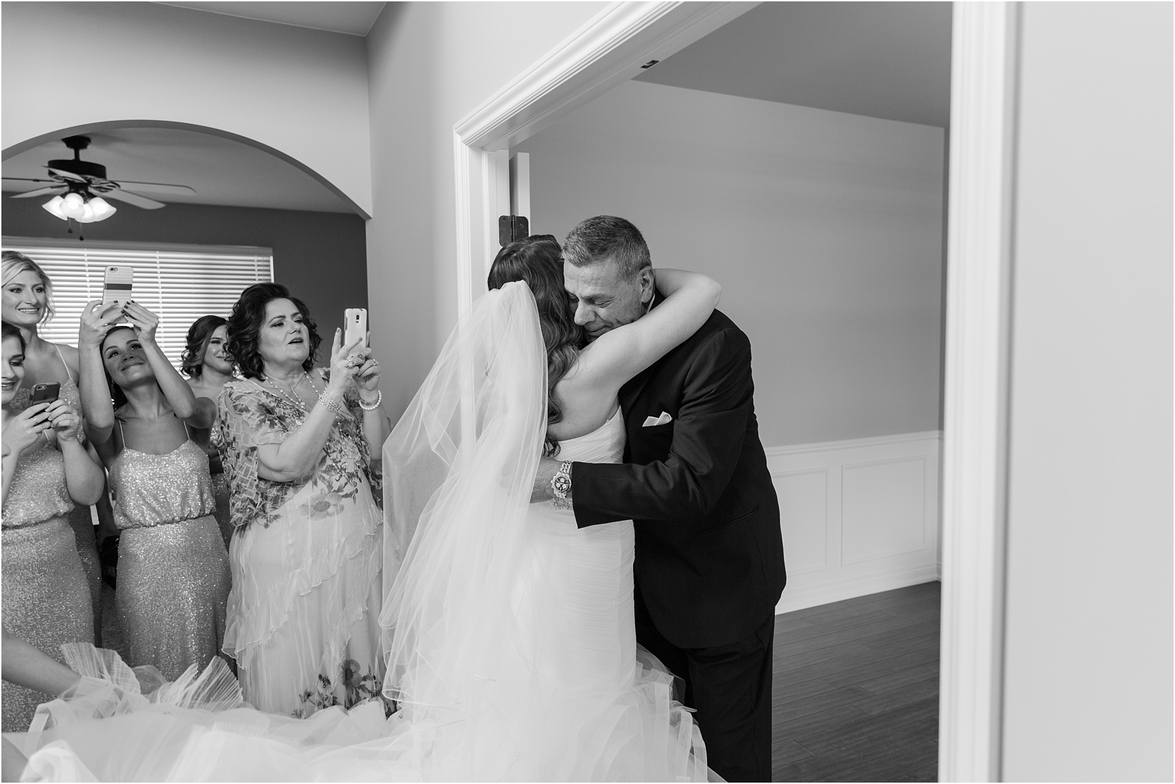 father-and-bride-share-emotional-first-look-on-wedding-day-photos-in-detroit-michigan-by-courtney-carolyn-photography_0016.jpg