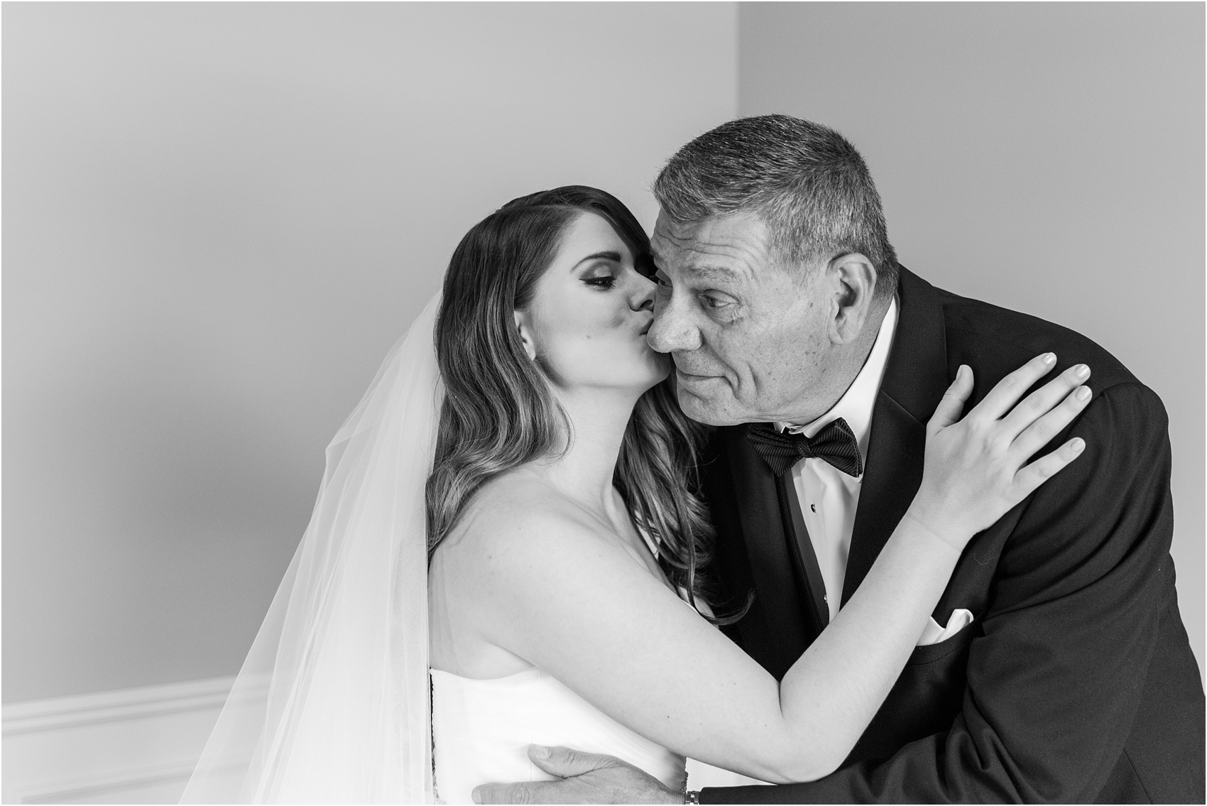 father-and-bride-share-emotional-first-look-on-wedding-day-photos-in-detroit-michigan-by-courtney-carolyn-photography_0021.jpg