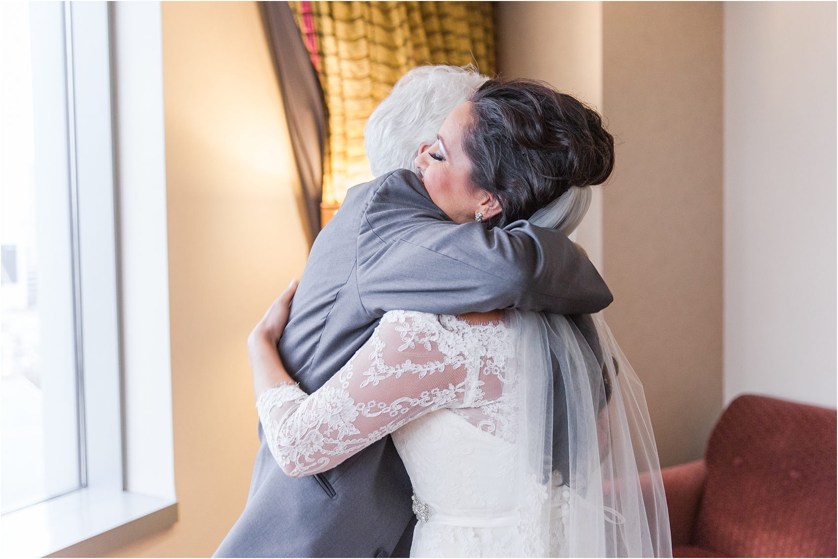 father-and-bride-share-emotional-first-look-on-wedding-day-photos-in-detroit-michigan-by-courtney-carolyn-photography_0035.jpg