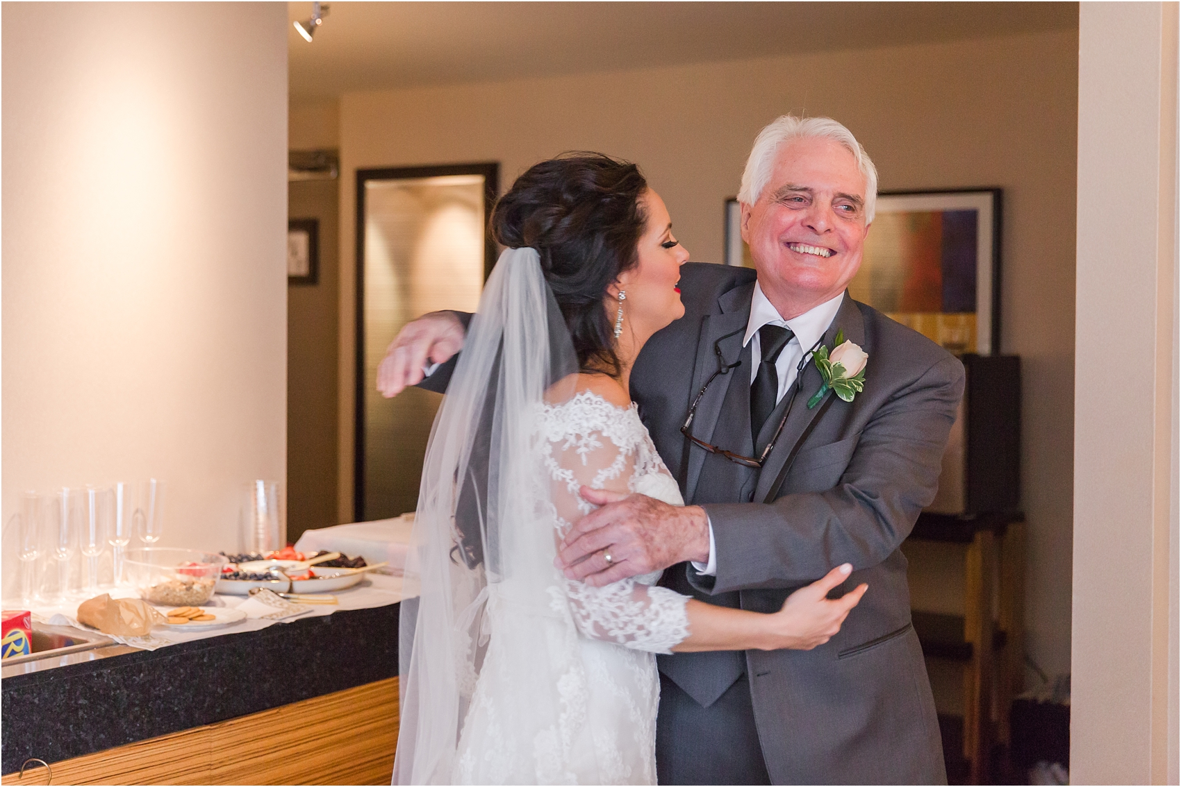father-and-bride-share-emotional-first-look-on-wedding-day-photos-in-detroit-michigan-by-courtney-carolyn-photography_0038.jpg