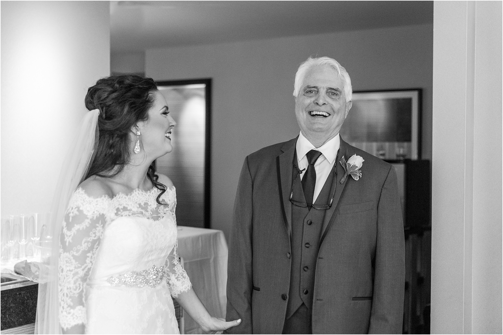 father-and-bride-share-emotional-first-look-on-wedding-day-photos-in-detroit-michigan-by-courtney-carolyn-photography_0039.jpg