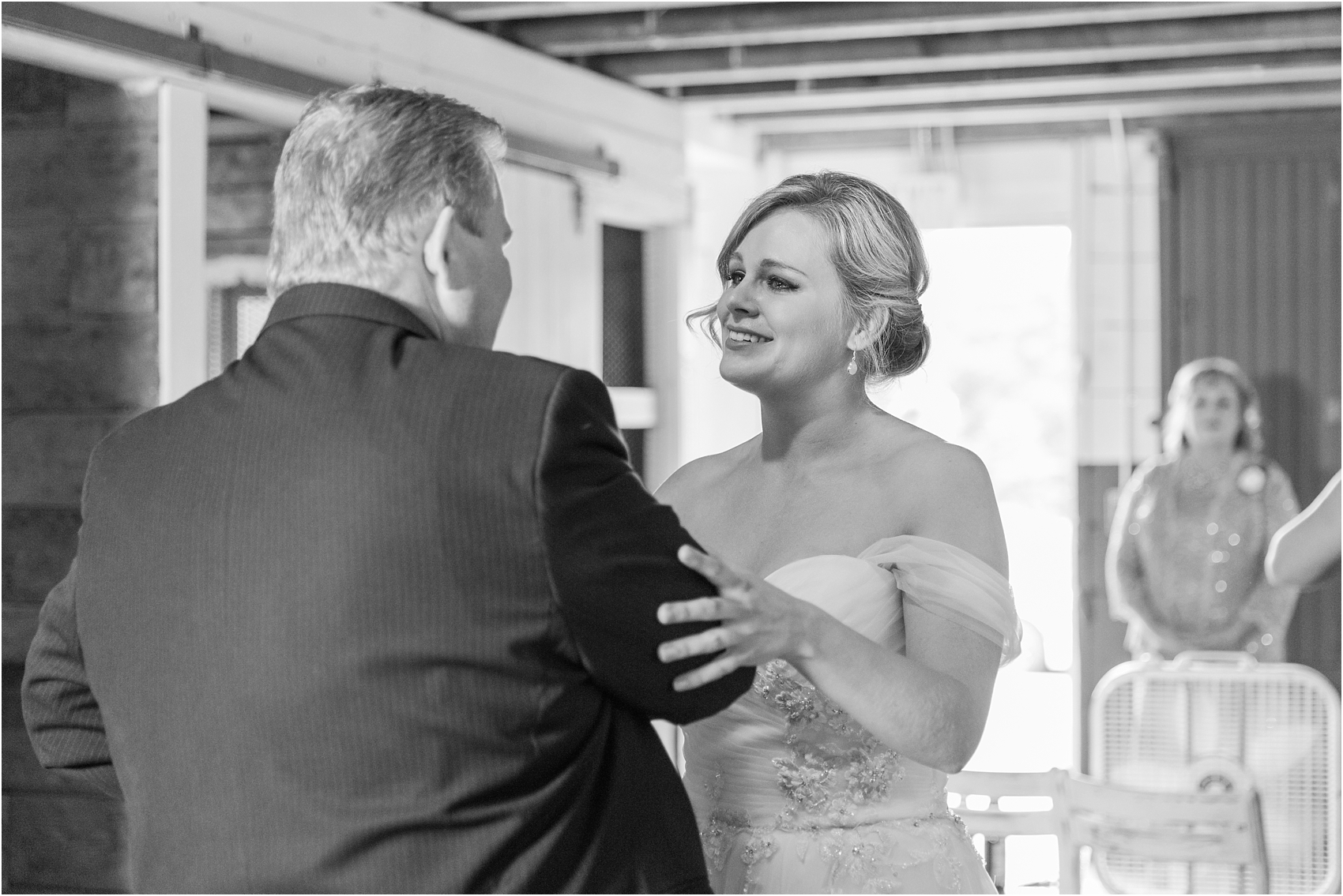 father-and-bride-share-emotional-first-look-on-wedding-day-photos-in-detroit-michigan-by-courtney-carolyn-photography_0042.jpg