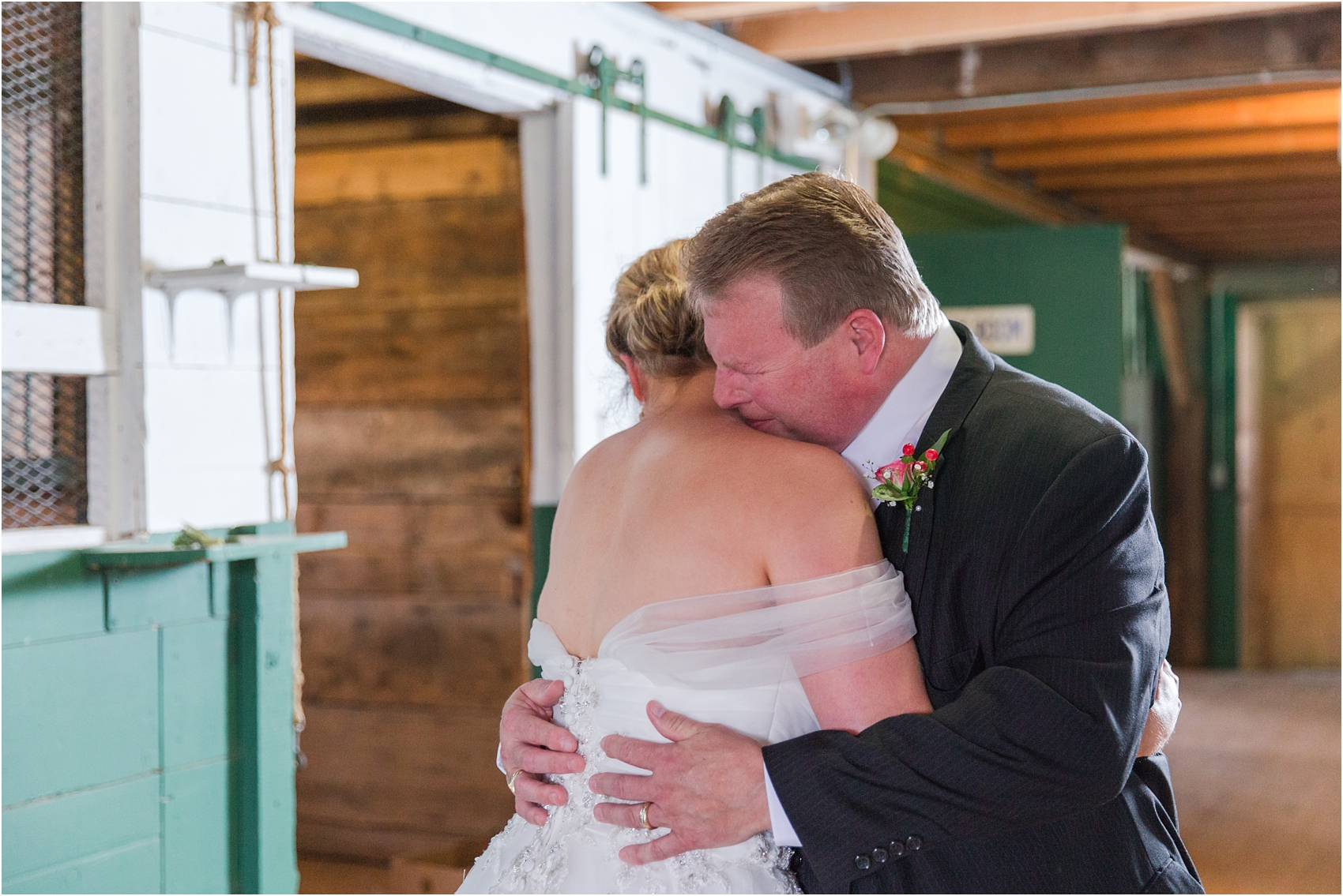 father-and-bride-share-emotional-first-look-on-wedding-day-photos-in-detroit-michigan-by-courtney-carolyn-photography_0043.jpg