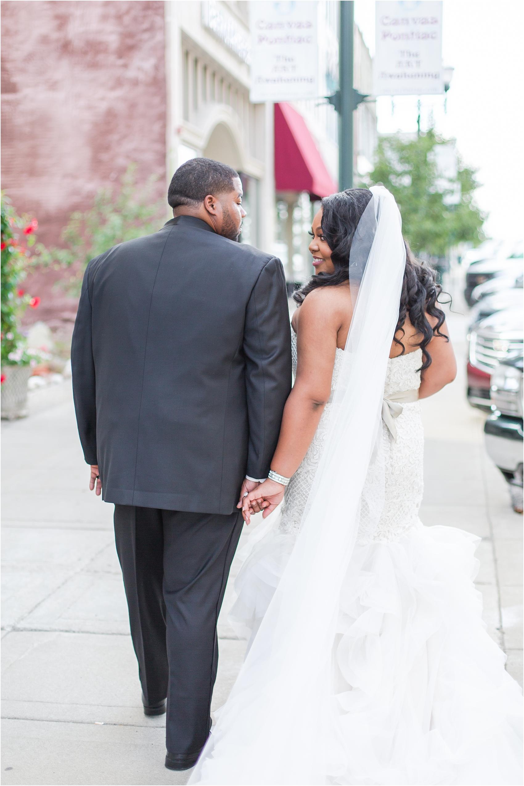 minimalist-and-modern-wedding-photos-at-30-north-saginaw-in-pontiac-michigan-by-courtney-carolyn-photography_0055.jpg