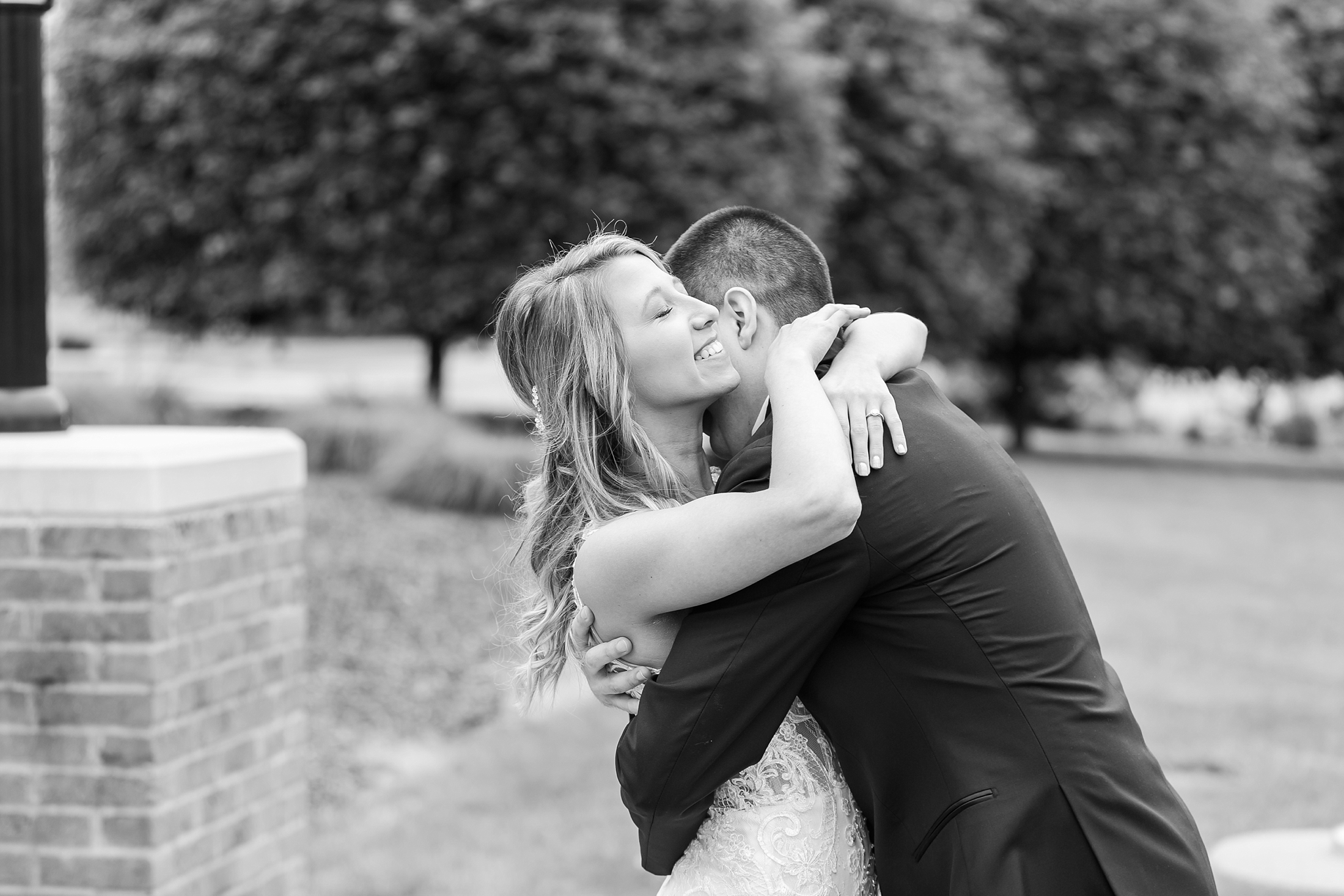 candid-romantic-wedding-photos-at-the-h-hotel-in-midland-michigan-by-courtney-carolyn-photography_0028.jpg
