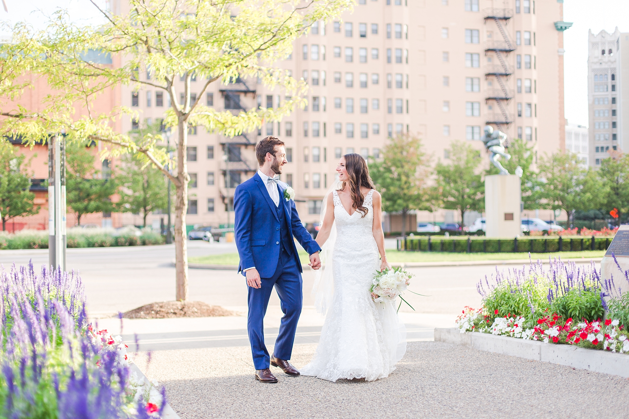 playful-blush-navy-wedding-photos-the-detroit-athletic-club-in-detroit-michigan-by-courtney-carolyn-photography_0042.jpg