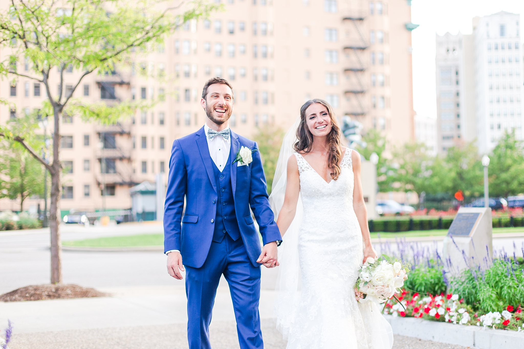 playful-blush-navy-wedding-photos-the-detroit-athletic-club-in-detroit-michigan-by-courtney-carolyn-photography_0057.jpg