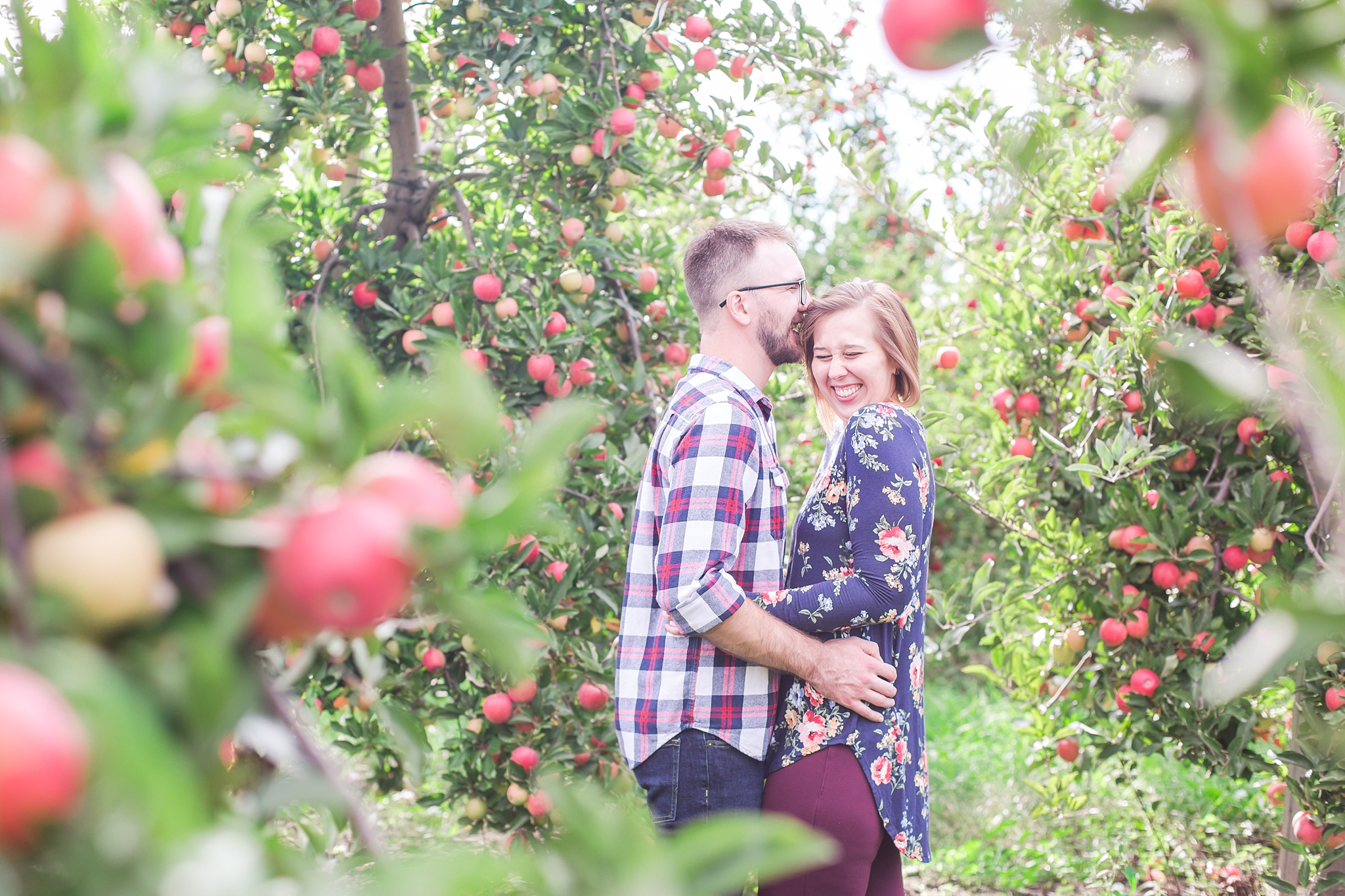playful-fall-engagement-photos-at-hy's-cider-mill-ochard-in-bruce-township-michigan-by-courtney-carolyn-photography_0001.jpg