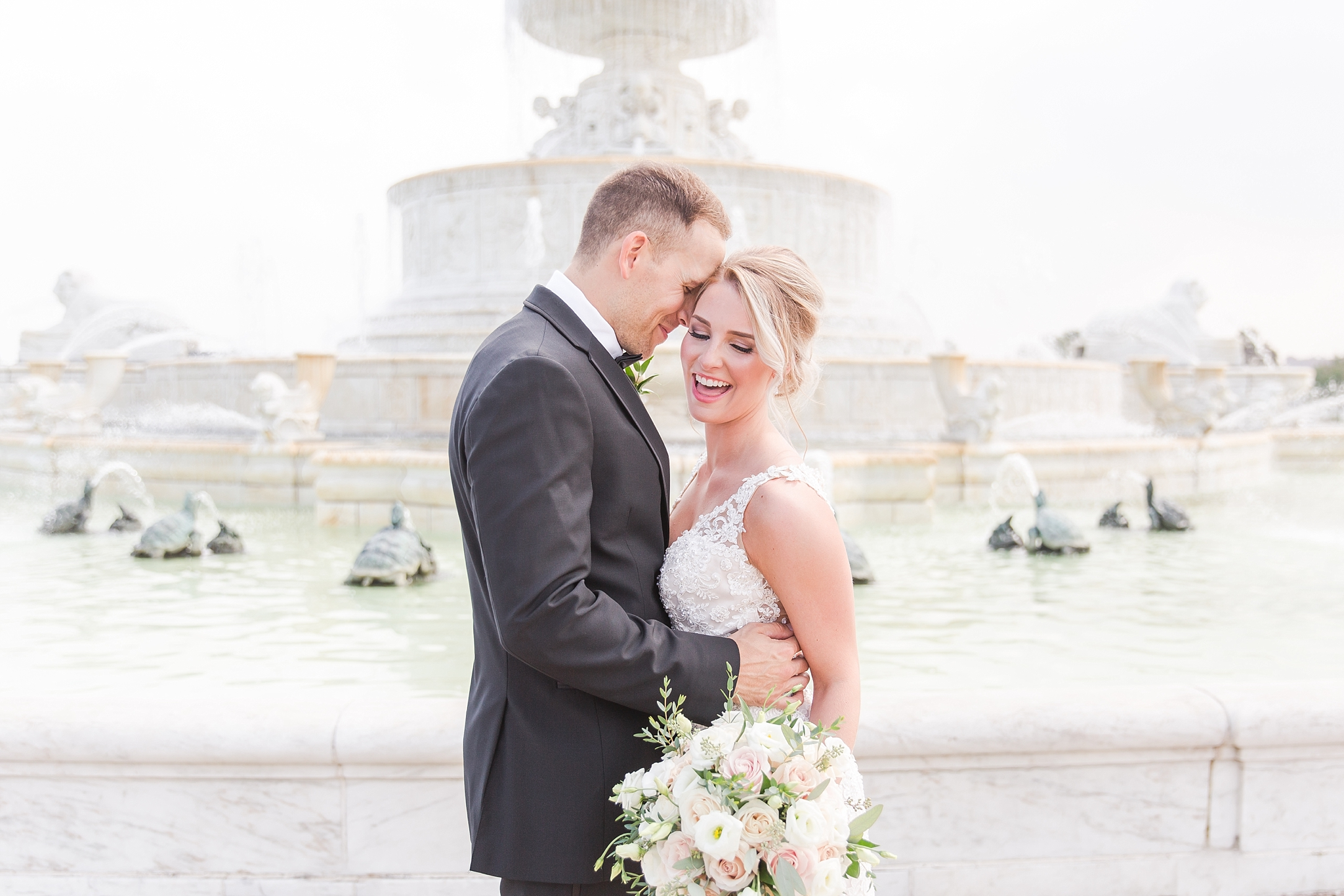 candid-romantic-wedding-photos-at-the-masonic-temple-belle-isle-detroit-institute-of-arts-in-detroit-michigan-by-courtney-carolyn-photography_0049.jpg