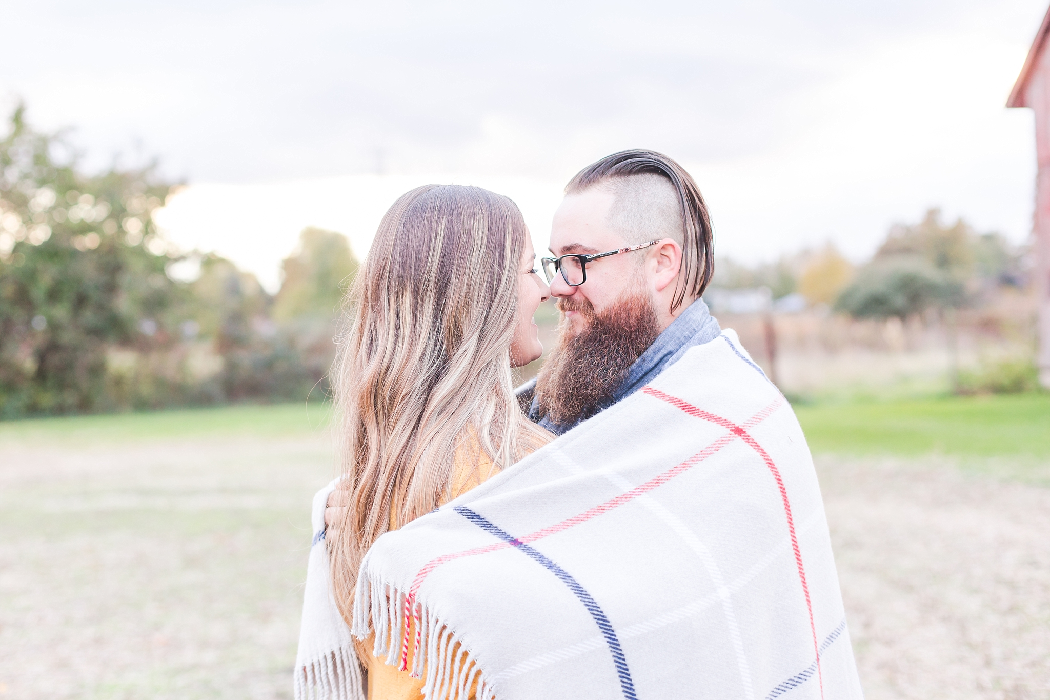 cozy-fall-engagement-photos-at-an-old-family-farm-in-monroe-michigan-by-courtney-carolyn-photography_0019.jpg