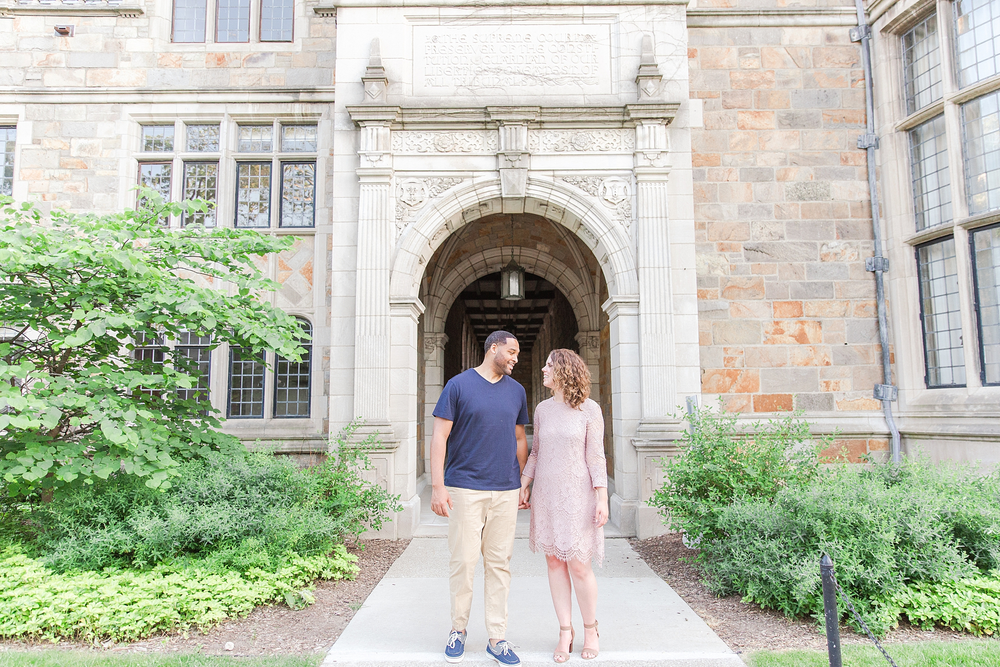 joyful-college-campus-engagement-photography-at-university-of-michigan-in-ann-arbor-mi-by-courtney-carolyn-photography_0002.jpg