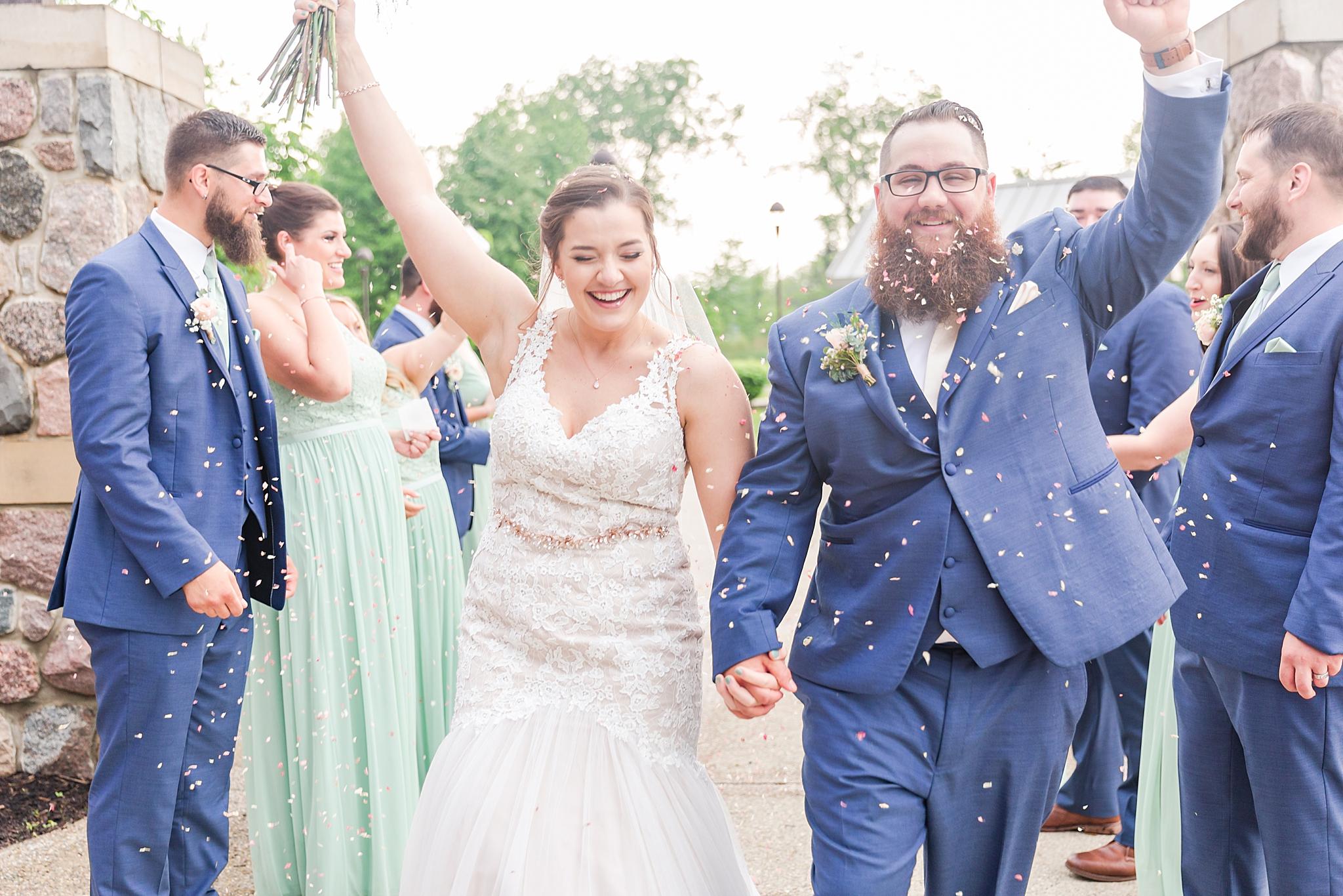 detroit-wedding-photographer-brownstown-event-center-wedding-photos-sam-josh-by-courtney-carolyn-photography_0071.jpg