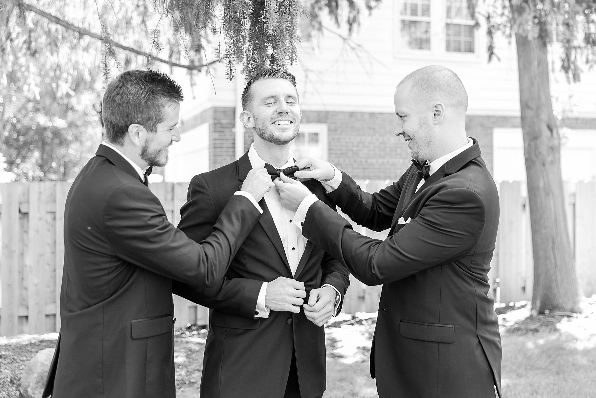 detroit-wedding-photographer-grosse-pointe-academy-chapel-detroit-golf-club-wedding-carly-matt-by-courtney-carolyn-photography_0006.jpg
