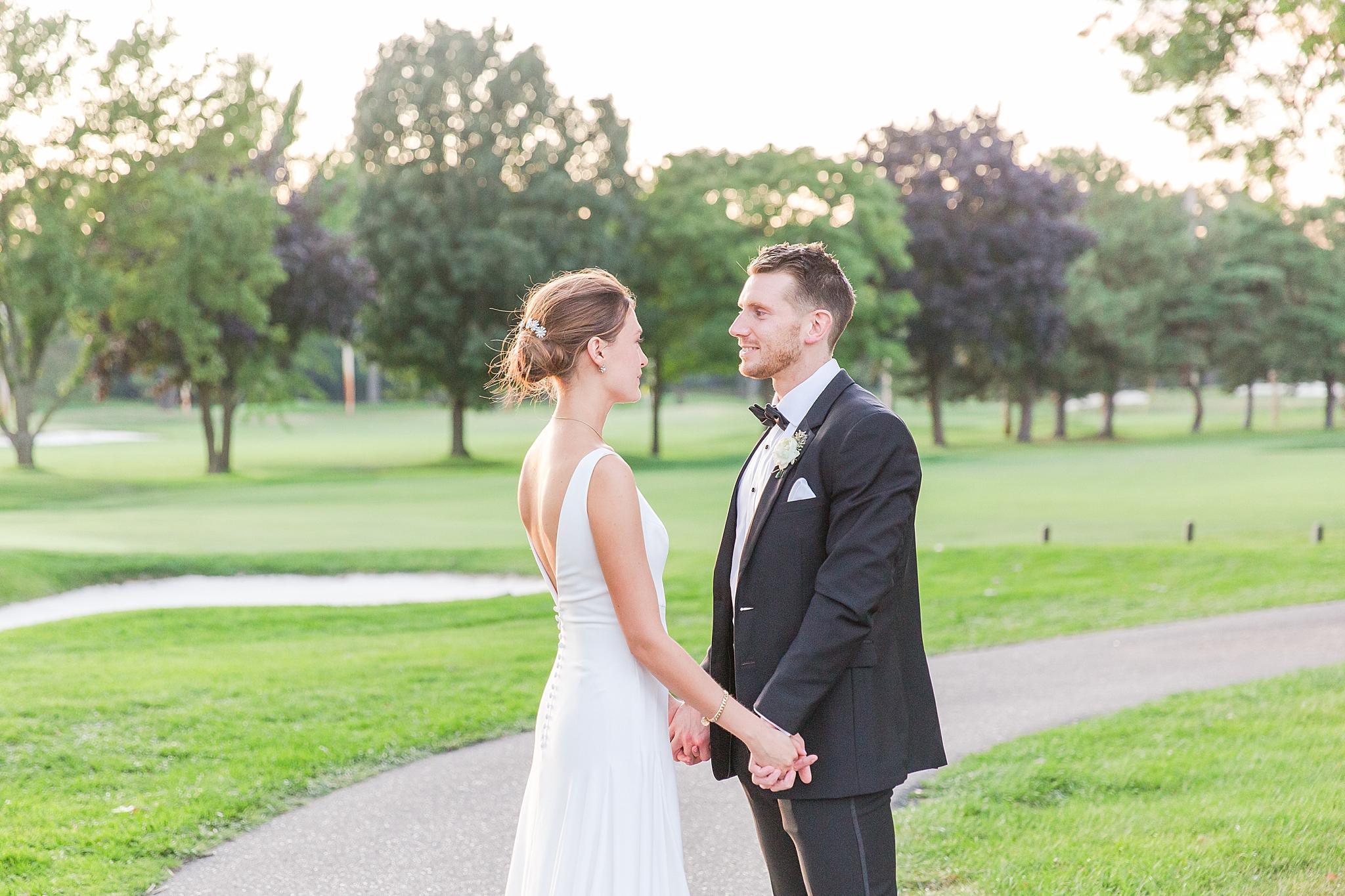 detroit-wedding-photographer-grosse-pointe-academy-chapel-detroit-golf-club-wedding-carly-matt-by-courtney-carolyn-photography_0121.jpg