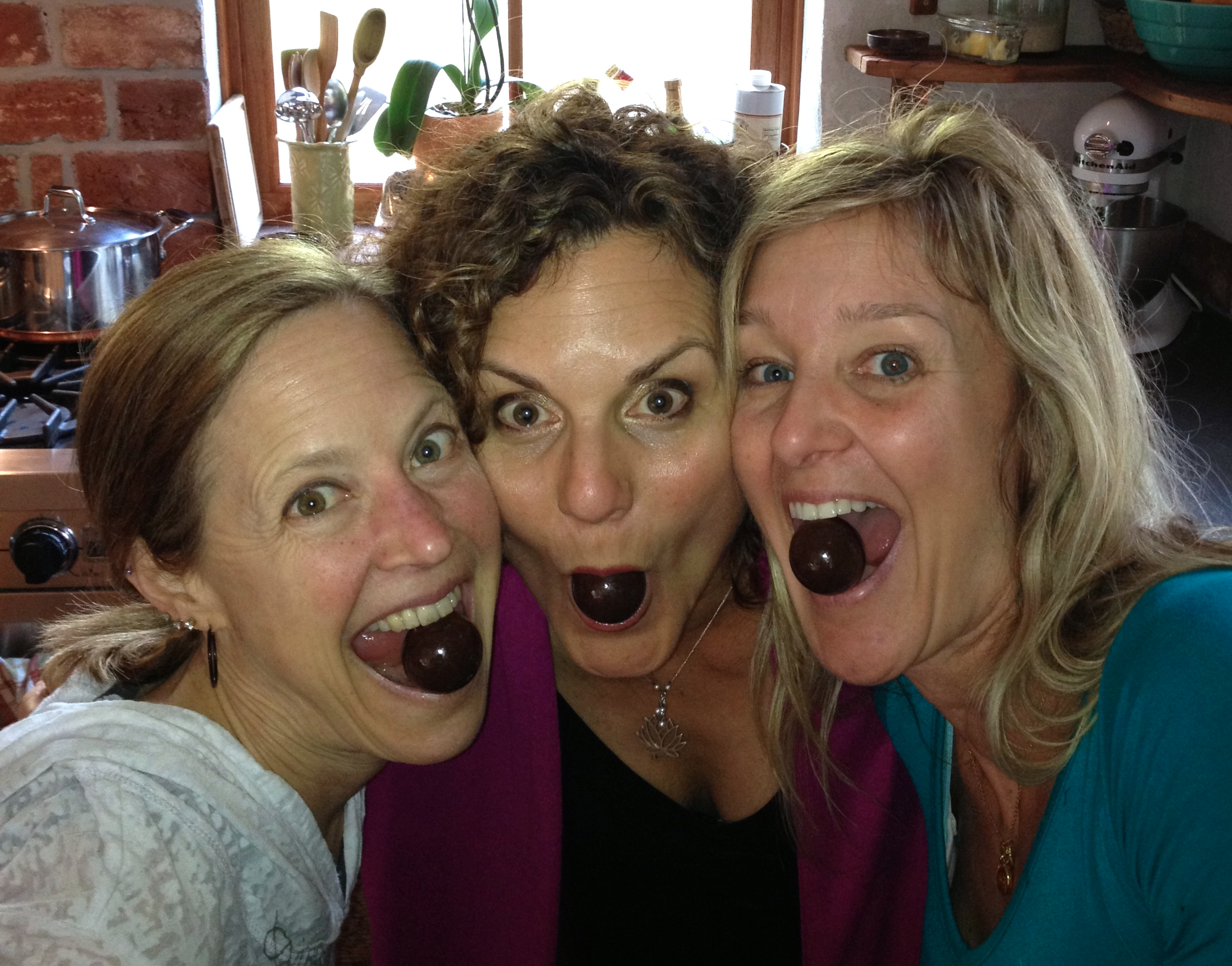 Lauren, Dr. Deb, and myself with peanut butter chocolate covered malted milk balls (my husband made us do it) moments after everyone left -- or of course, we would have shared :)