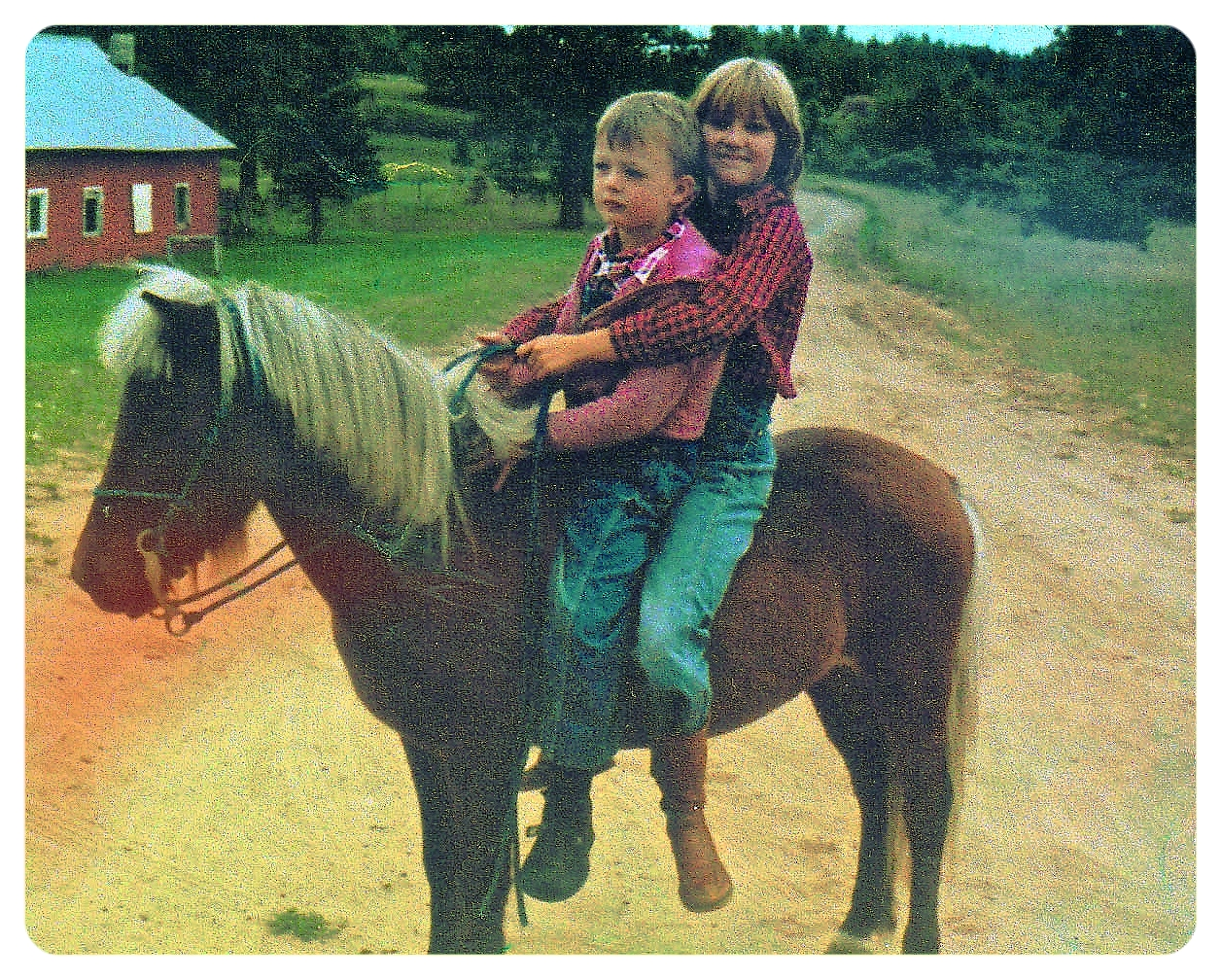 My cousin, Jimmy, and I on my first pony, Brandy.