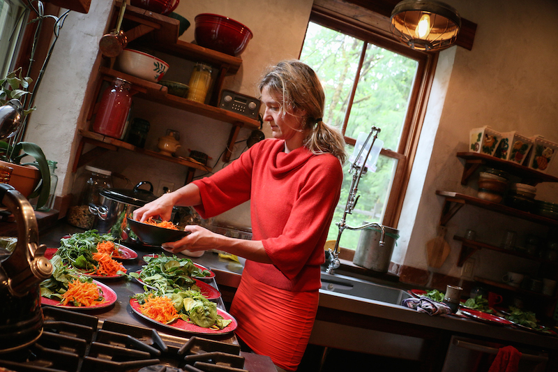 Britt adds the final touches on an ayurvedic meal prepared by students during a Teacher Training weekend