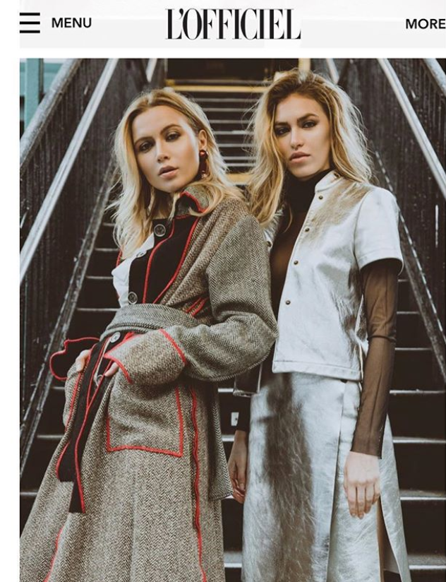 Two models in coat and suit by Marine Penvern, L'Officiel magazine; set in NYC subway station