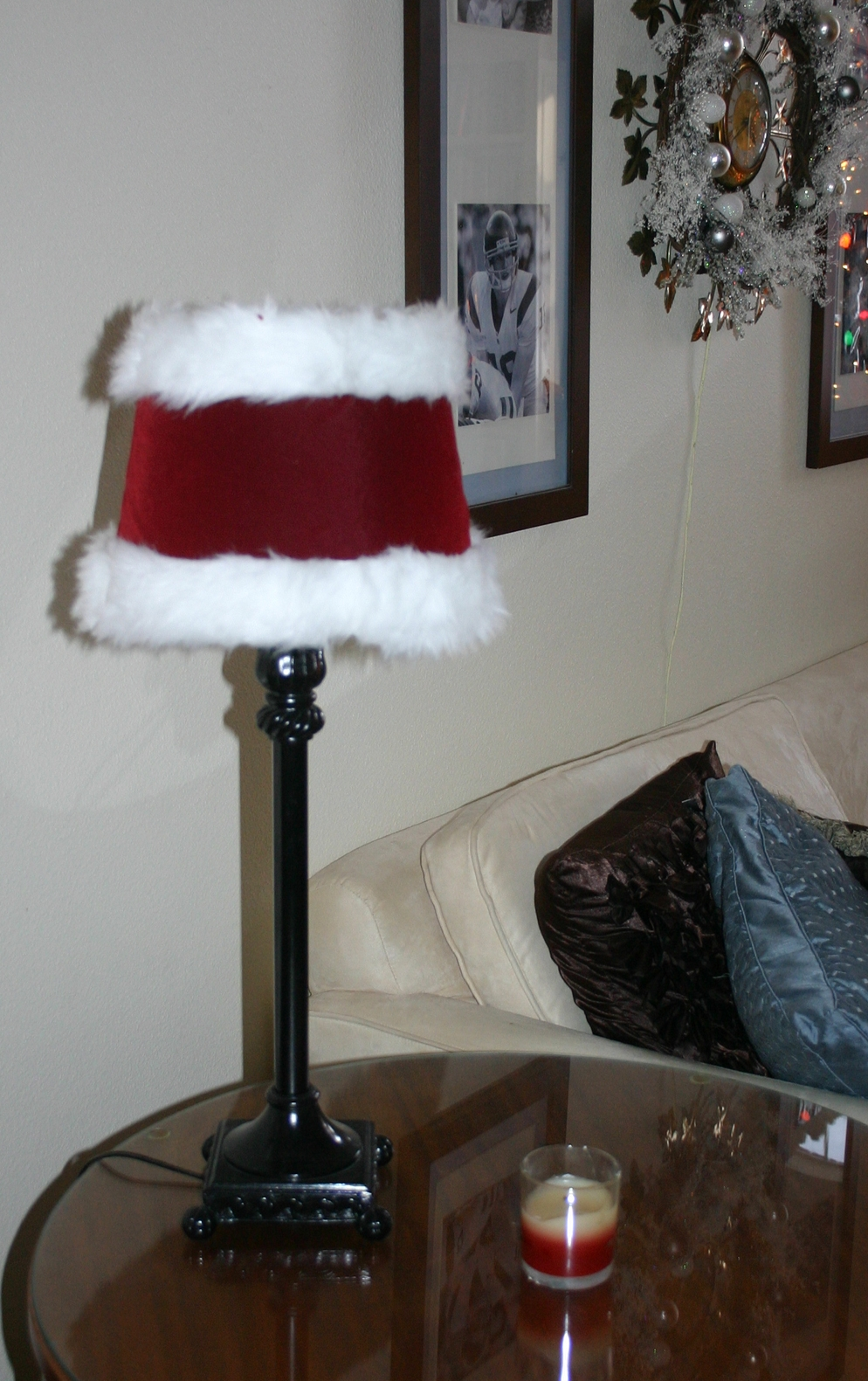 "A simple little ""Santa"" cover for the lamp shade.  I made it out of the scraps from the Raggedy Santa outfits!"