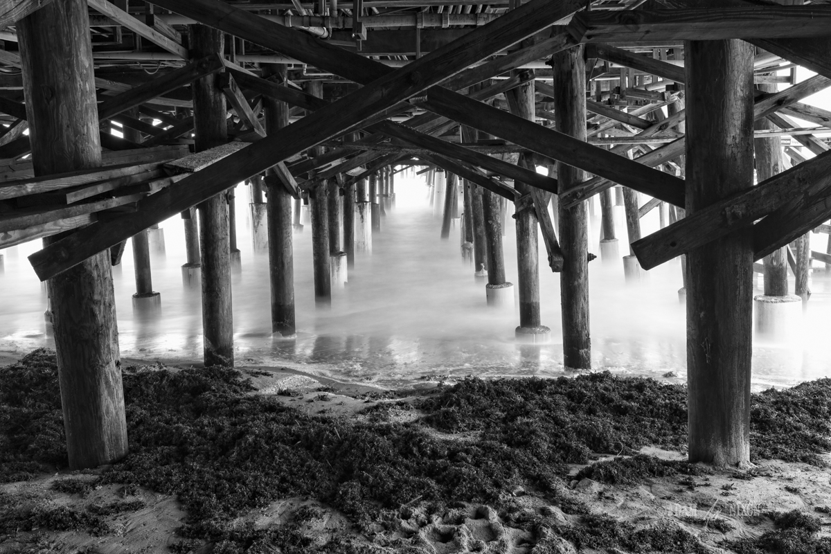 Underneath the Cocoa Beach Pier. Canon 5dIII w/16-35mm, 61sec @f/16, ISO 100. Processed in Lightroom 5, Photoshop CC 2014 and onOne Perfect B&W 9