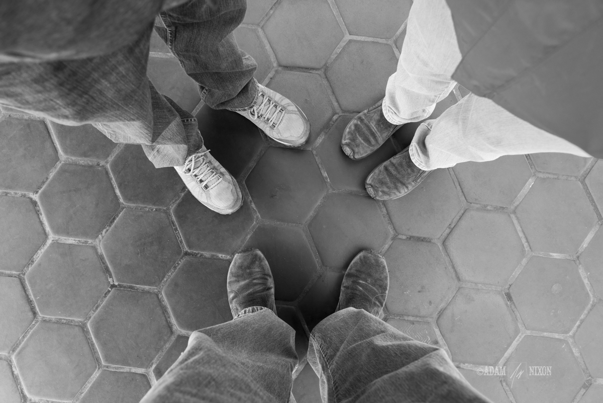 Looking down at the feet of a family of three
