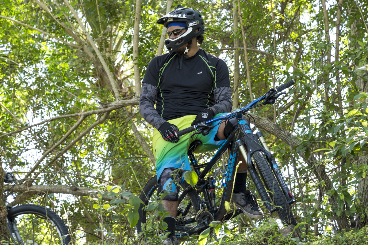 Mountain biker resting on the side of a trail
