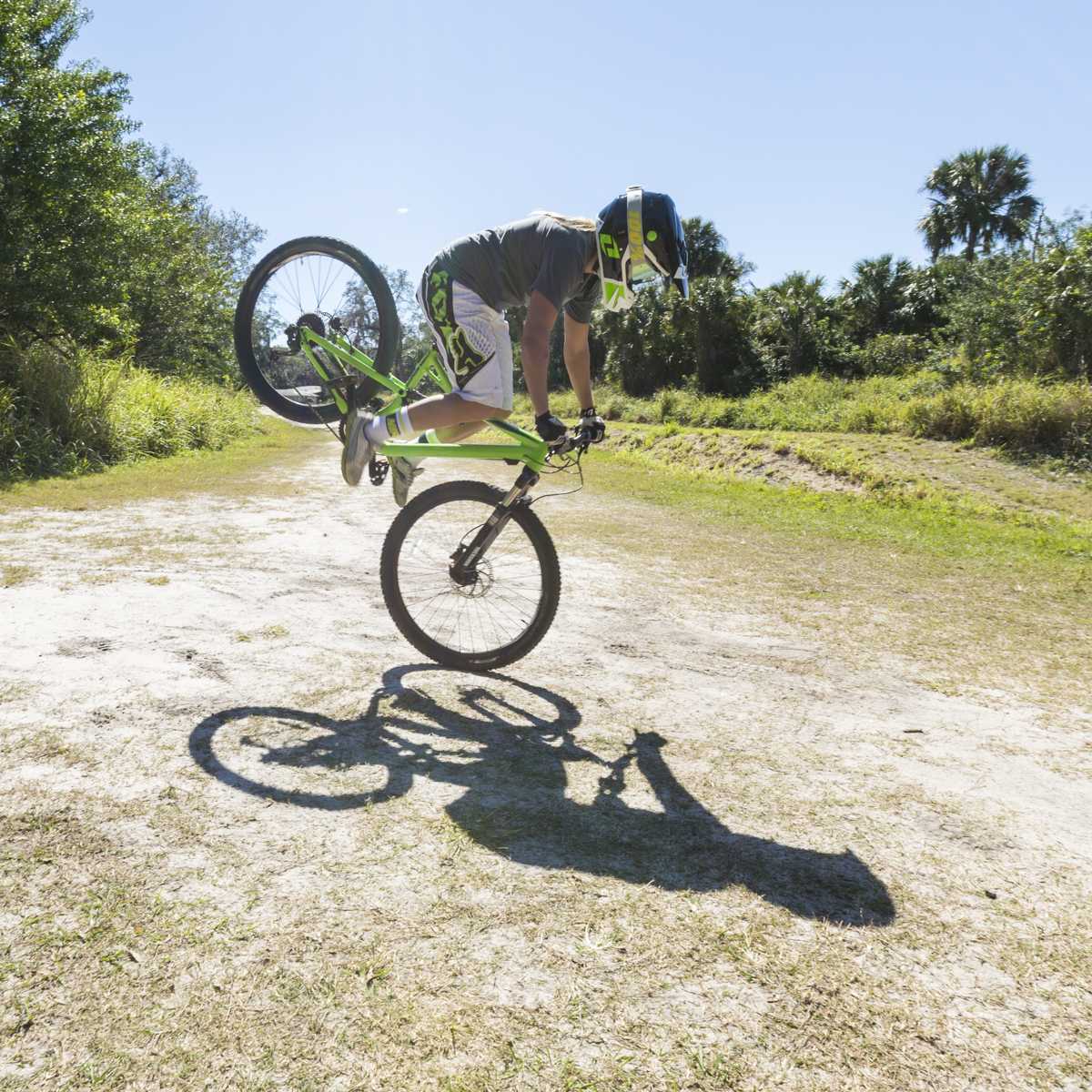 Mountain biker up on front wheel