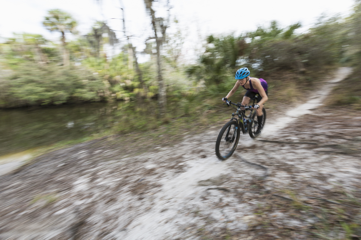 Female mountain biker riding the trails