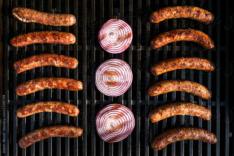 Bratwurst, Kielbasa and red onion on the grill