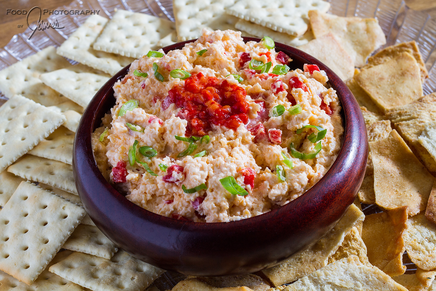 Southern Pimento Cheese   ·3 oz. cream cheese   · 1 cup mayonnaise   ·½ tsp. Worcestershire sauce   ·1 tsp. chopped green onion   ·1⁄8 tsp. cayenne pepper   ·8 oz. extra-sharp white Vermont cheddar cheese, finely grated   ·8 oz. sharp yellow cheddar cheese, finely grated   ·4-oz. jar pimentos, drained and finely diced   ·Hot sauce to taste  Place cream cheese, mayonnaise, Worcestershire sauce, green onion and cayenne in the bowl of a food processor. Process until smooth. Add extra-sharp and sharp cheese and pulse a few times, just until the shredded cheese and mayonnaise mixture is well blended. The mixture should not be completely smooth.  Scrape the cheese mixture into a bowl and stir in the diced pimentos. Add hot sauce to taste, cover and chill for a few hours to allow flavors to blend.