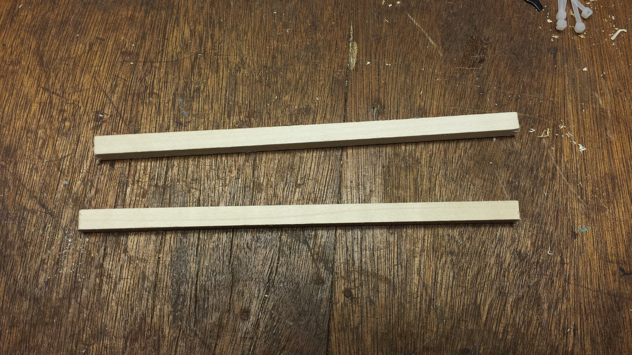 "Two 9.5"" Pieces of 3/8"" Square Dowel"