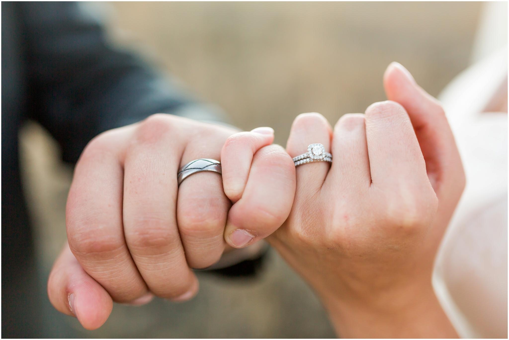 wedding rings on hands.JPG