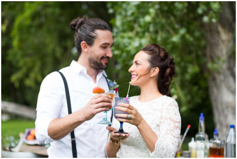 Couple_cheers_at_wedding.JPG