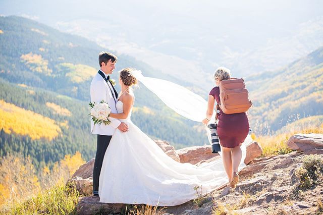 Just jumping on to say hello! It's been a LONG time since I posted a #bts on Instagram. I'm just doing the usual, laying out the train of a gorgeous #weddingdress while carrying about 20 lbs in photography gear on my body and balancing on rocks at 10,346 feet. This one is from last fall at Heather & Ethan's Wedding in #Vail at the Wedding Deck. Their wedding was super dreamy, and timeless! I'll be updating my feed after a busy #weddingseason so stay tuned for some highlights. . . . . . #vailwedding #vailweddingdeck #btsphotoshoot #coloradowedding #fallwedding #fall #weddingphotographer #vailweddingdeck #weddingphotography #coloradomountainwedding #brideandgroom