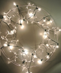 I got this wire wreath in Lincoln Park in Chicago at CB2. You can do anything you want with it. Put ornaments in it, clip photos to it, or hang lights on it. It is only $12.95 now and you can get one  here .