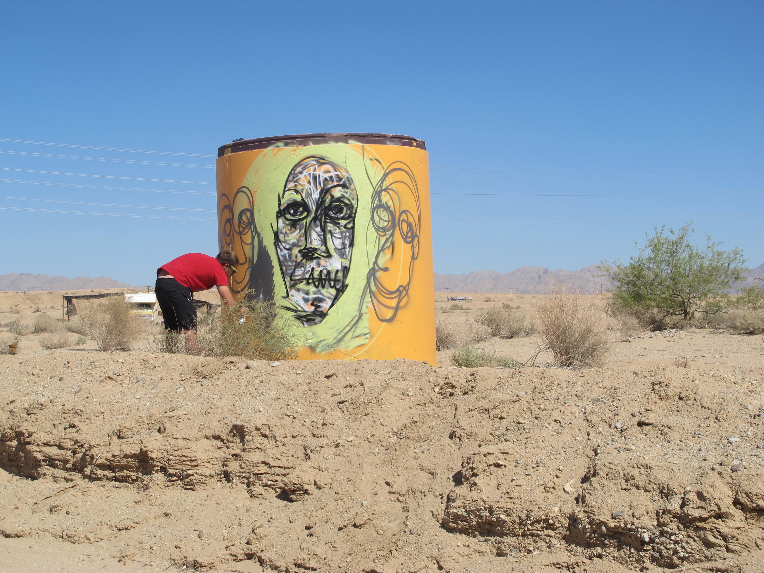 the face in the center is the very first thing i painted at  slab city  and i believe it to be an accurate response or feeling of this unusual place...after painting what i may consider a ghost of slab city i began adding  lighthearted imagery more akin to my painting style