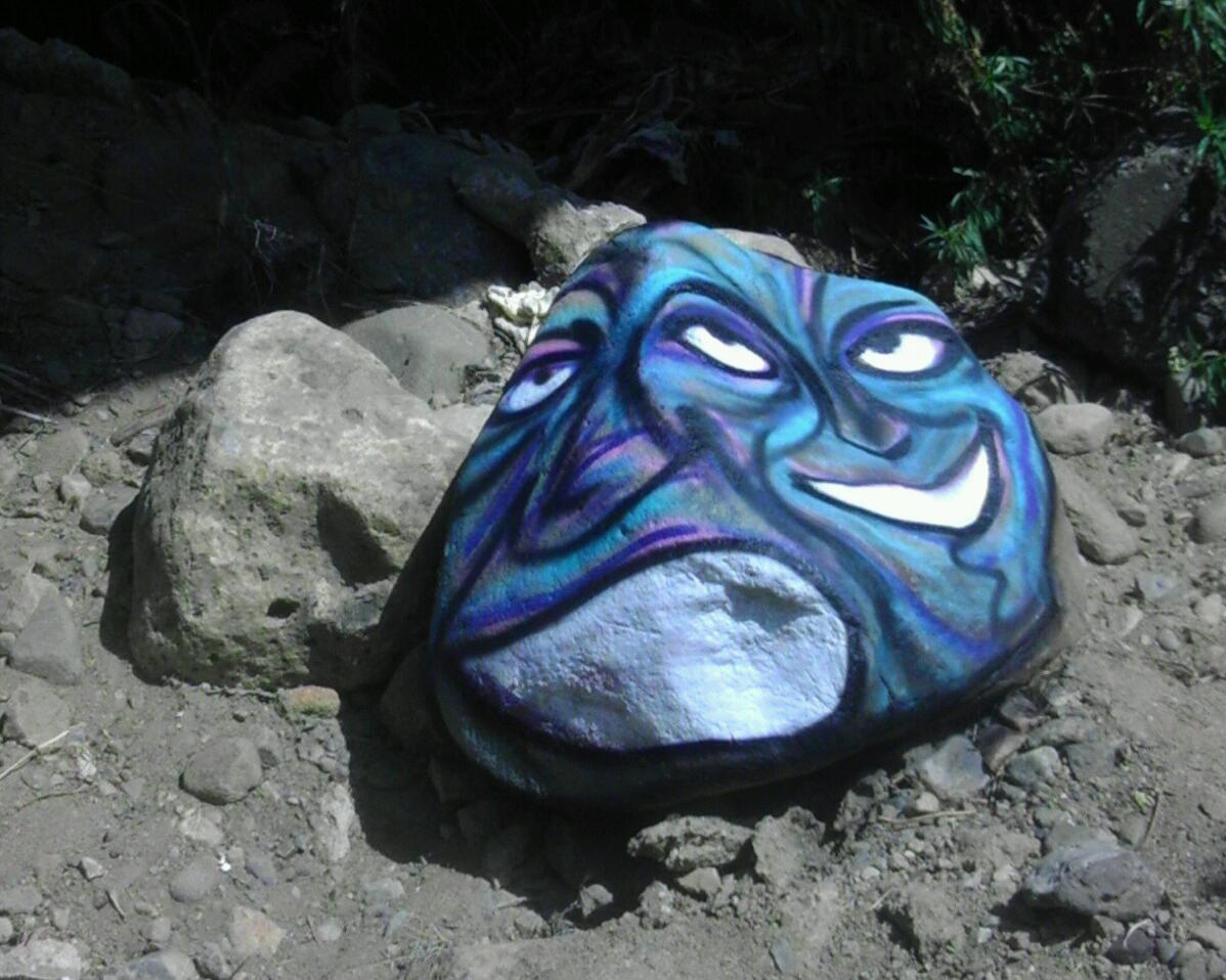 for whatever reason i've never felt comfortable painting on anything natural but once i did i definitely enjoyed it....the contours of this rock really lent themselves to the faces i've added