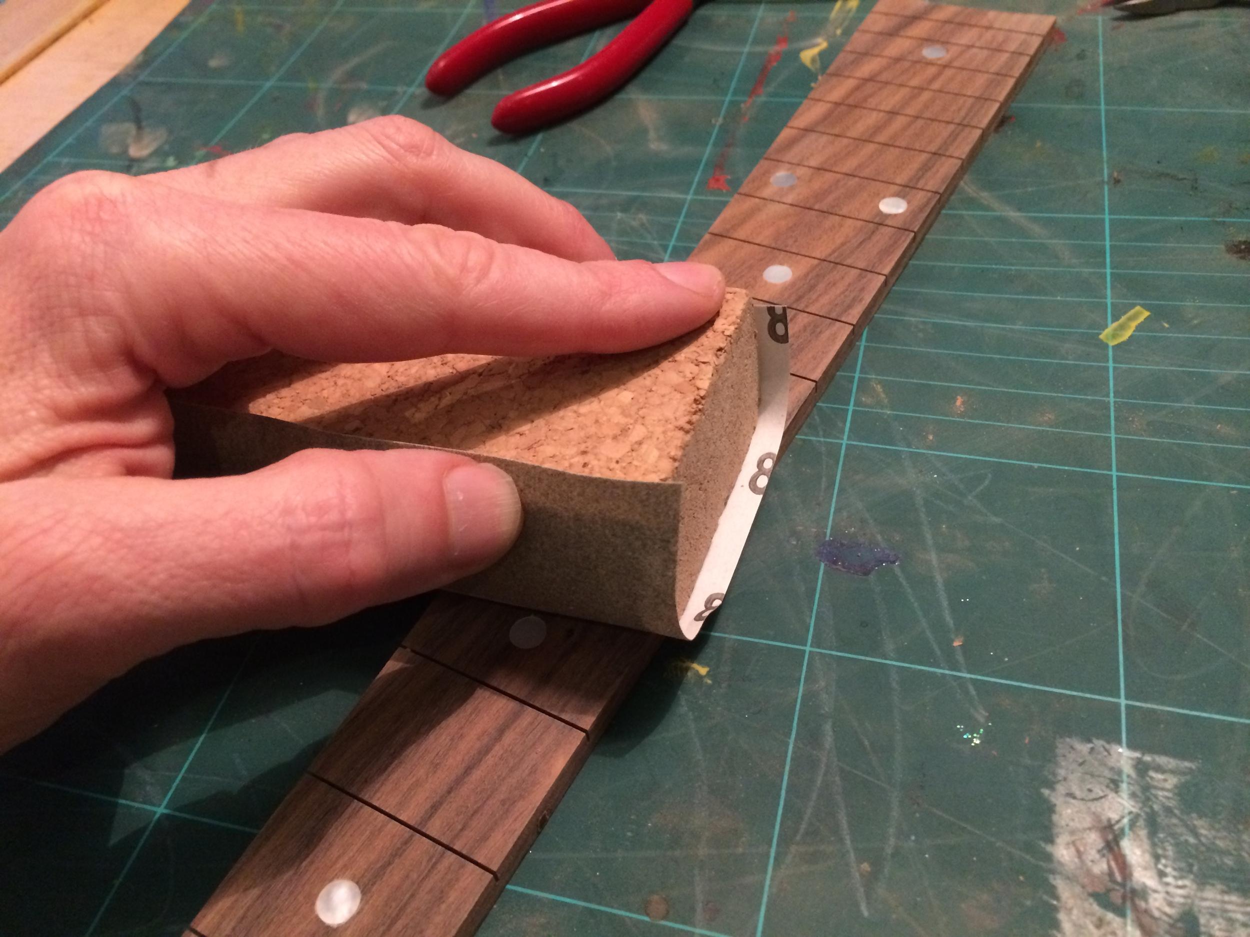 Flattening the fretboard
