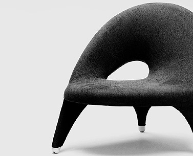 ARABESK: 1955  |                                      Folke Jansson                          Three-leg armchair with metal frame covered with expanded foam. Not removable covering in fabric..