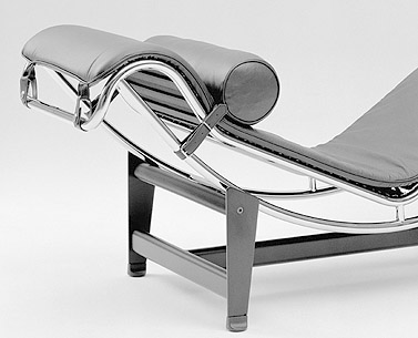 CO07:  1927-28  |                                        Le Corbusier                                       Tubular steel chaise, frame in epoxy enamel or polished chrome. Base in sheet and tubular steel with black epoxy finish. Headrest in leather. Pad in leather or cowhide.        The chaise longue was initially produced by Thonet France and from 1930 onwards by Embru in Switzerland. In 1959, Heidi Weber re-interpreted the chaise longue together with other Le Corbusier's designs with the direct collaboration of the designer himself.