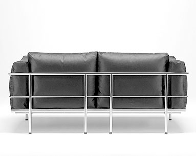 CO22:  1927-28  |                                        Le Corbusier                                       Two seat sofa with tubular steel frame in epoxy enamel or polished chrome. Removable cushions in foam and down. Upholstery in leather or fabric.