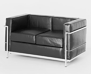 CO32:  1927-28  |                                        Le Corbusier                                       Two seat sofa with tubular steel frame in epoxy enamel or polished chrome. Cushions in expanded foam and polyester fiber. Upholstery in leather or fabric.