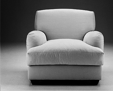 FR91:  1930  |                                      Jean Michel Frank                                       Armchair with hardwood frame covered with expanded foam and polyester fiber. Cushions in down. Removable fabric slip cover.