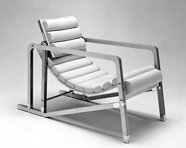 "GR07:  1927  |                                      Eileen Gray                          Armchair with frame in lacquered wood. Not removable seat and back upholstered and covered in leather. Hardware in chromed or gold-plated brass. Available also with frame in visible, transparent lacquered birch plywood.   This deck chair too was used to furnish the lounge of Villa E 1027. The design of the deck chair was registered by  Eileen Gray and Jean Badovici in 1927 under the name ""Transat""."