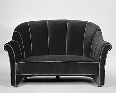 HO22:  1911  |                                      Josef Hoffmann                                       Two-seat sofa with hardwood frame covered with expanded foam. Not removable upholstery in velvet with striped piping.