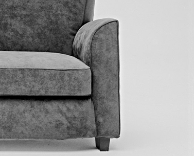 LE81: 1929-30  |                                      Jules Leleu                                       Armchair with hardwood frame and metal reiforced back lined with expanded foam and covered in cotton fabric. Cushions in foam covered in cotton fabric. Upholstery options are leather or removable fabric slip cover. Feet in Italian nut with beeswax finish.